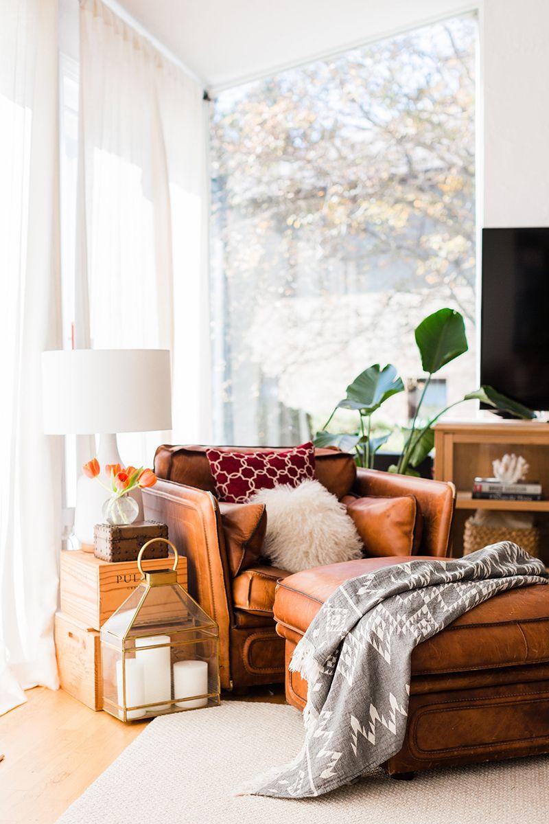 #livingroom #leatherarmchair #rusticshelves #theeverygirl