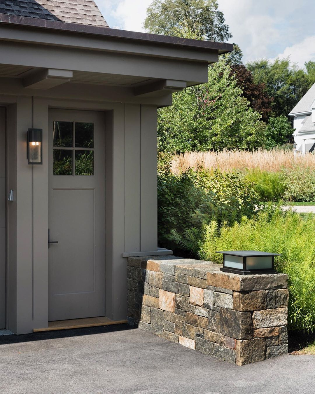 Mcld Llc On Instagram A Short Stone Retainingwall Topped By A Custom Lightfixture Creates An Attractive And Inviting In 2020 Inviting Outdoor Decor Retaining Wall