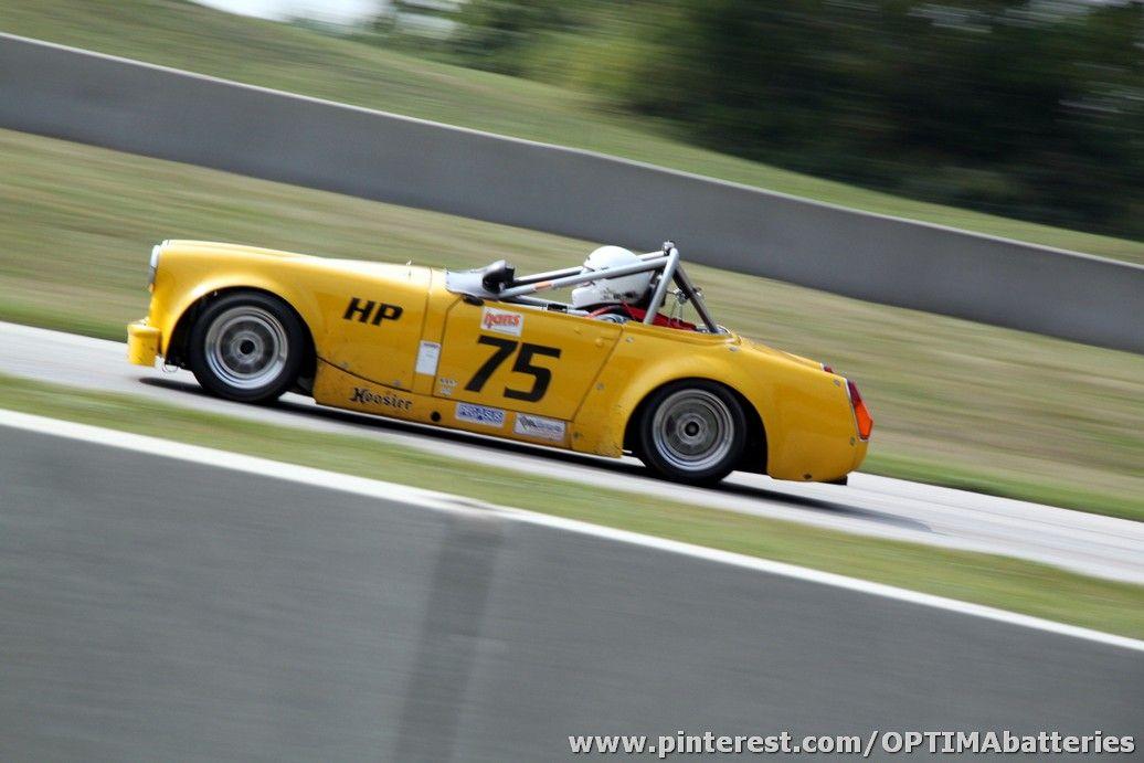 Jack Shulz's yellow 1970 MG Midget racing H Production at