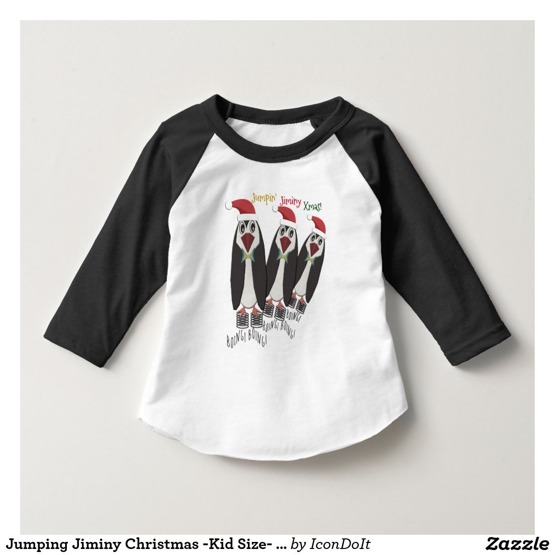 """Jumping Jiminy #Christmas - #Kid_Size- #Funny_Penguins_T-Shirt - Get your kids in the holiday spirit w/ this snazzy black & white baseball style shirt featuring a trio of cute penguins dressed in their Santa Hats, bow ties, and (literally!) a spring in their step. Captions surrounding their super strength coiled spring shoes read """"Boing! Boing!"""" in black. Top caption (in gold, red & green) reads """"Jumpin' Jiminy Xmas!"""" This #funny original design is by digital artist, Leslie Sigal Javorek."""
