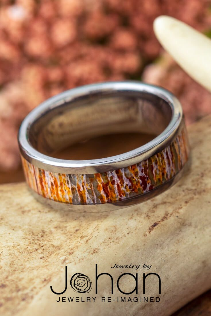 Wear a piece of nature with this orange deer antler #weddingband ! This outdoors-inspired design is crafted in titanium for durability and comfort. #JewelrybyJohan