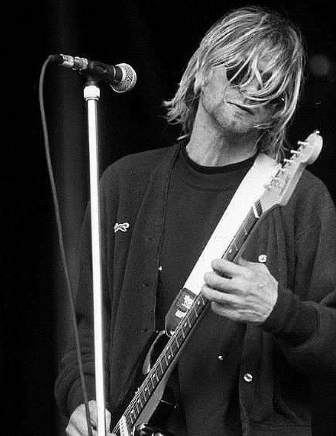 Idk why he's playing the guitar right handed | Nirvana ...