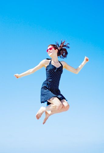 Young Woman Jumping High In Air