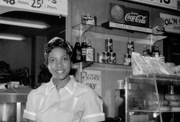 """1950s.Helen Ann Smith poses at the counter of the Harlem House, a restaurant chain based in Memphis to serve African-American customers who were denied service at lunch counters in the South. """"That is such a beautiful picture,"""" Withers said. """"This location was on Beale Street and it was very, very popular with musicians."""" Photographer Ernest Withers"""