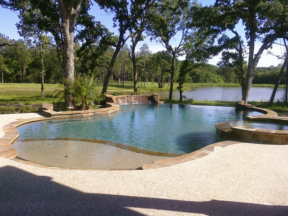 Freeform Pool And Spa With Beach Entry And Infinity Edge Swimming Pools Backyard Pool Designs Swimming Pool Designs