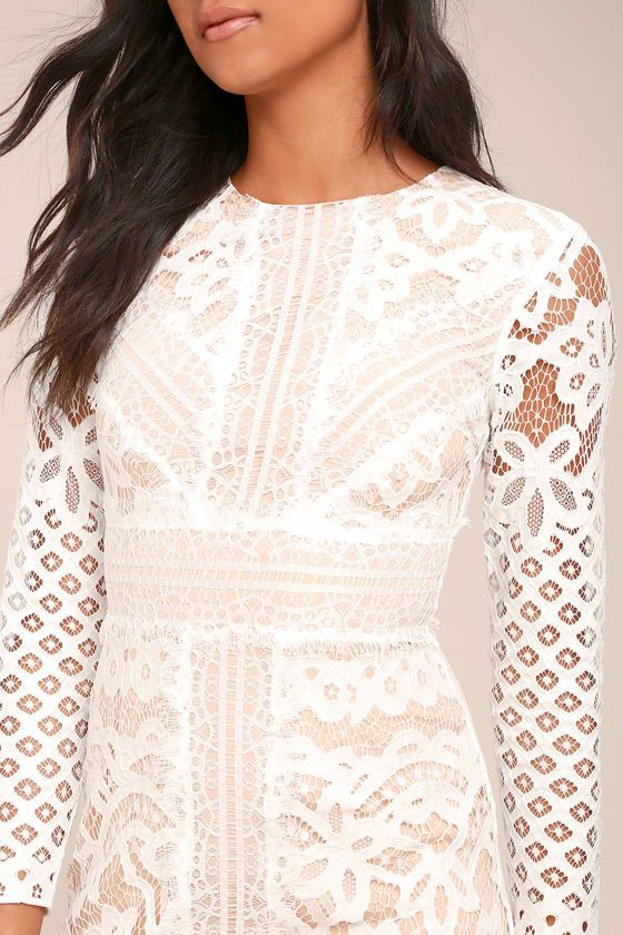 For an instant romantic look, just slip on the Keepsake Bridges White Lace Long Sleeve Midi Dress! Stunning white eyelash lace overlay, and nude knit, shapes a rounded neckline, and long sleeve bodice with pierced crochet detail throughout. A-line midi skirt ends at a sheer hem. Back zipper.
