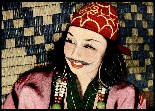 One of the Last of the Mustashioed Ainu Beauties of OLD JAPAN,  circa 1923