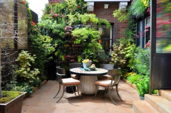 Small back yard with a lovely table setting https