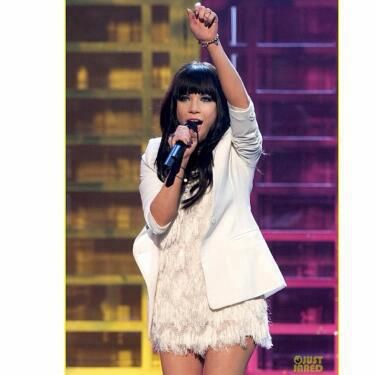 Carly Rae Jepsen performing at the American Music Awards wearing Whitney Eve