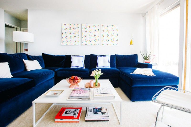 White Coffee Table Navy Blue Velvet Sofa Mosaic Wall Decoration Cream Rug White Walls Magazines Blue Sofa Living Blue Sofas Living Room Blue Couch Living Room