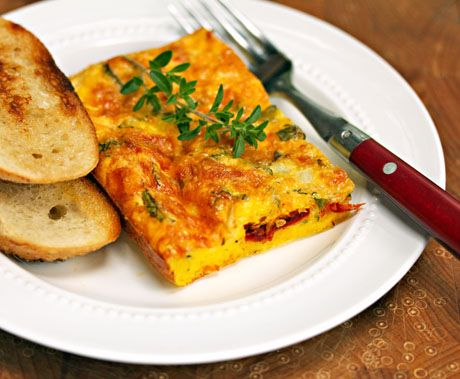 Egg casserole with Italian cheese, sun-dried tomatoes and fresh herbs, for breakfast or light supper.