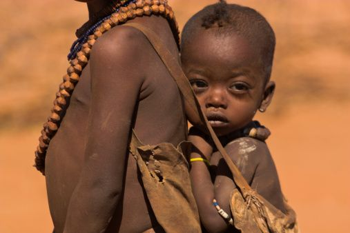 Ethiopia, Lower Omo valley, Tumi, Dombo village (Hamer peoples) Young girl & baby sister