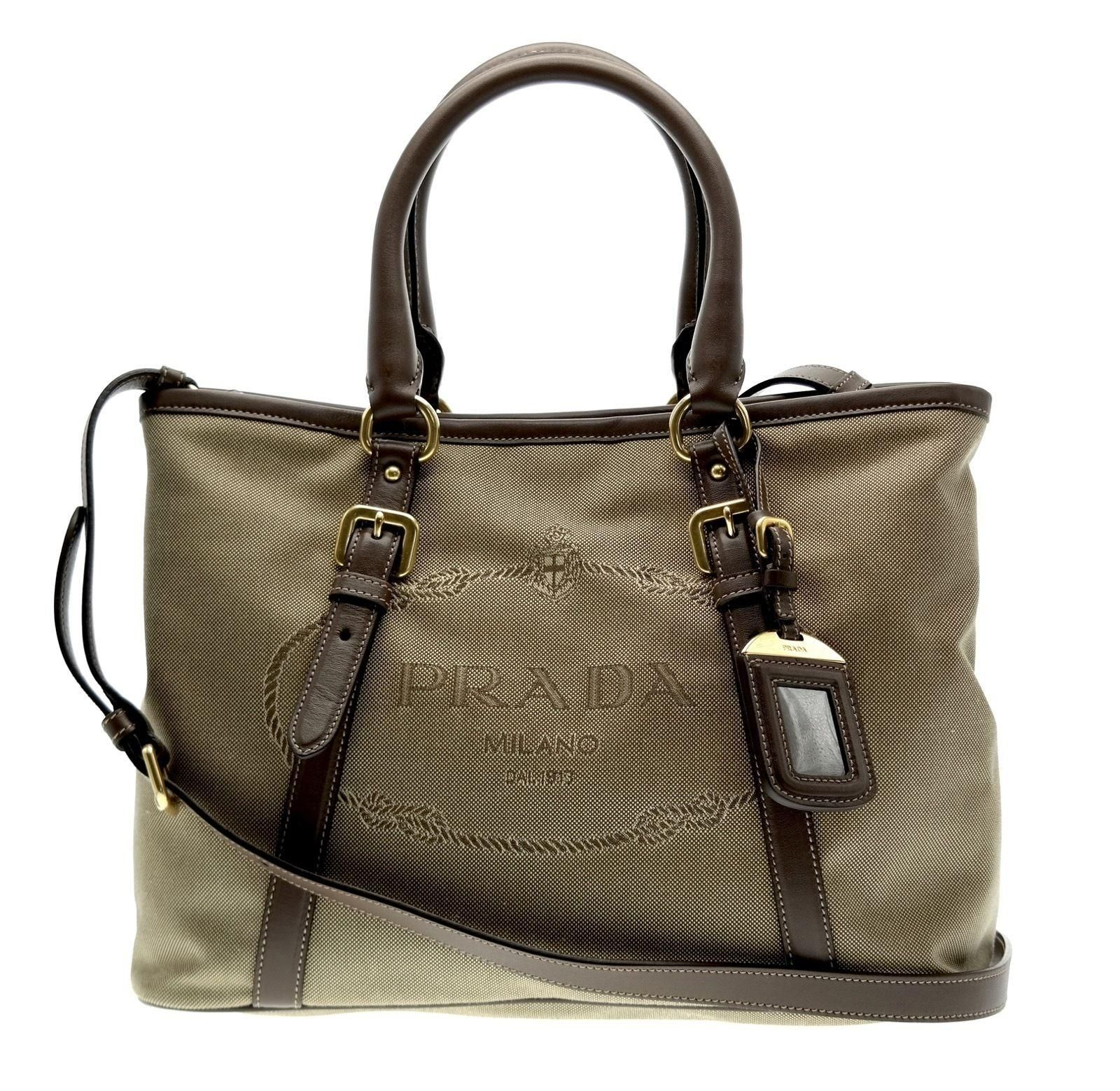 e30238da8bc8 Get one of the hottest styles of the season! The Prada Logo Jacquard Canvas  Tote Hand Crossbody Shoulder Bag is a top 10 member favorite on Tradesy.