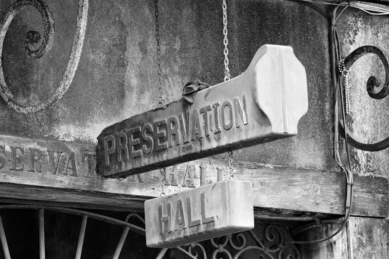 Black and white fine art photograph of the old trombone case sign that hangs over the