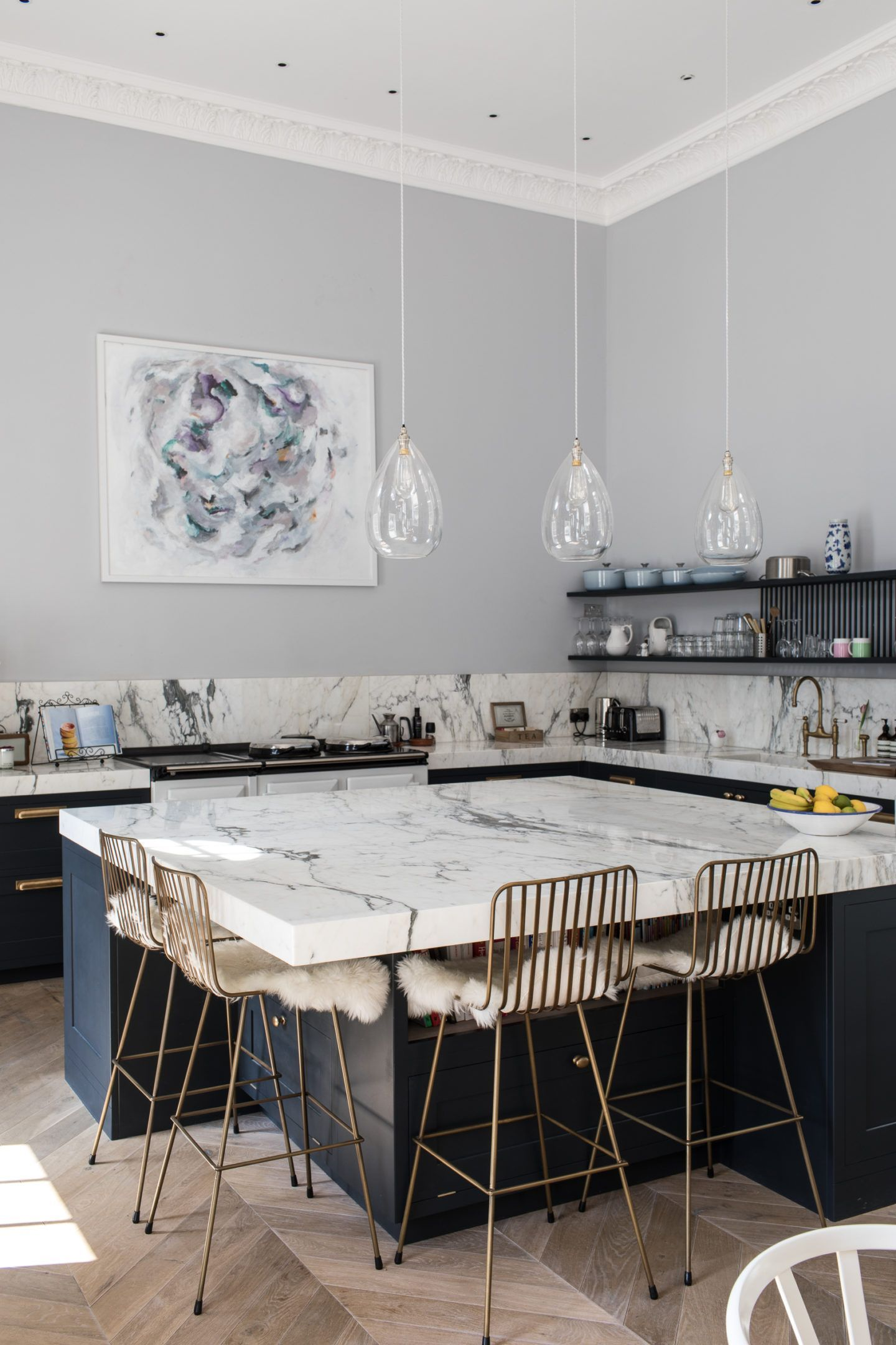 Marble kitchen island brass chairs sheepskins airy pendants all good