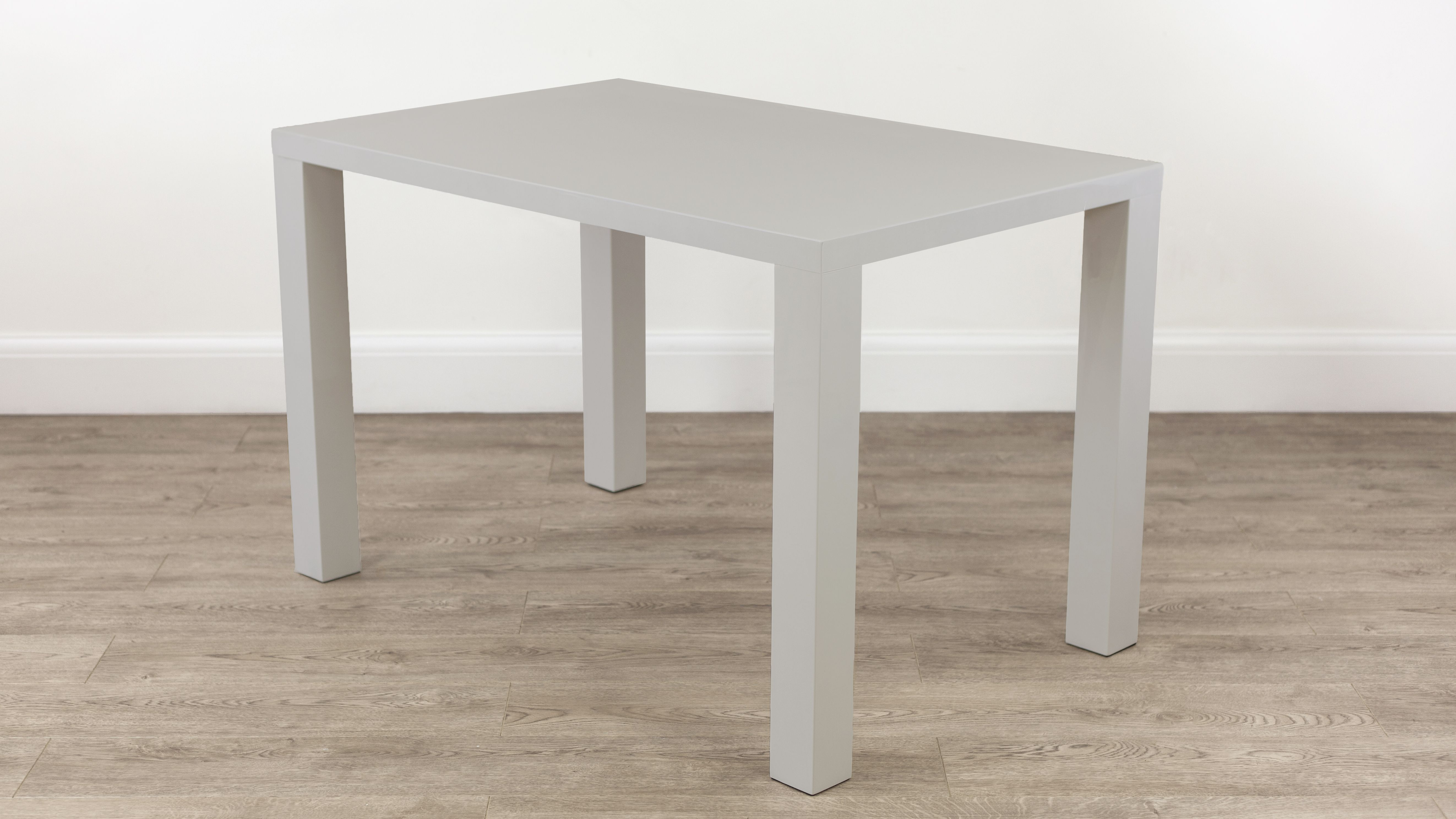 A lovely grey gloss 4 seater dining table, available for delivery ...