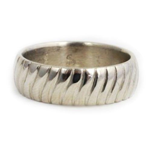 Unique handmade peridot sierra custom wedding band. Custom ring by Abby Sparks Jewelry, custom jewelry designer in Denver, Colorado.