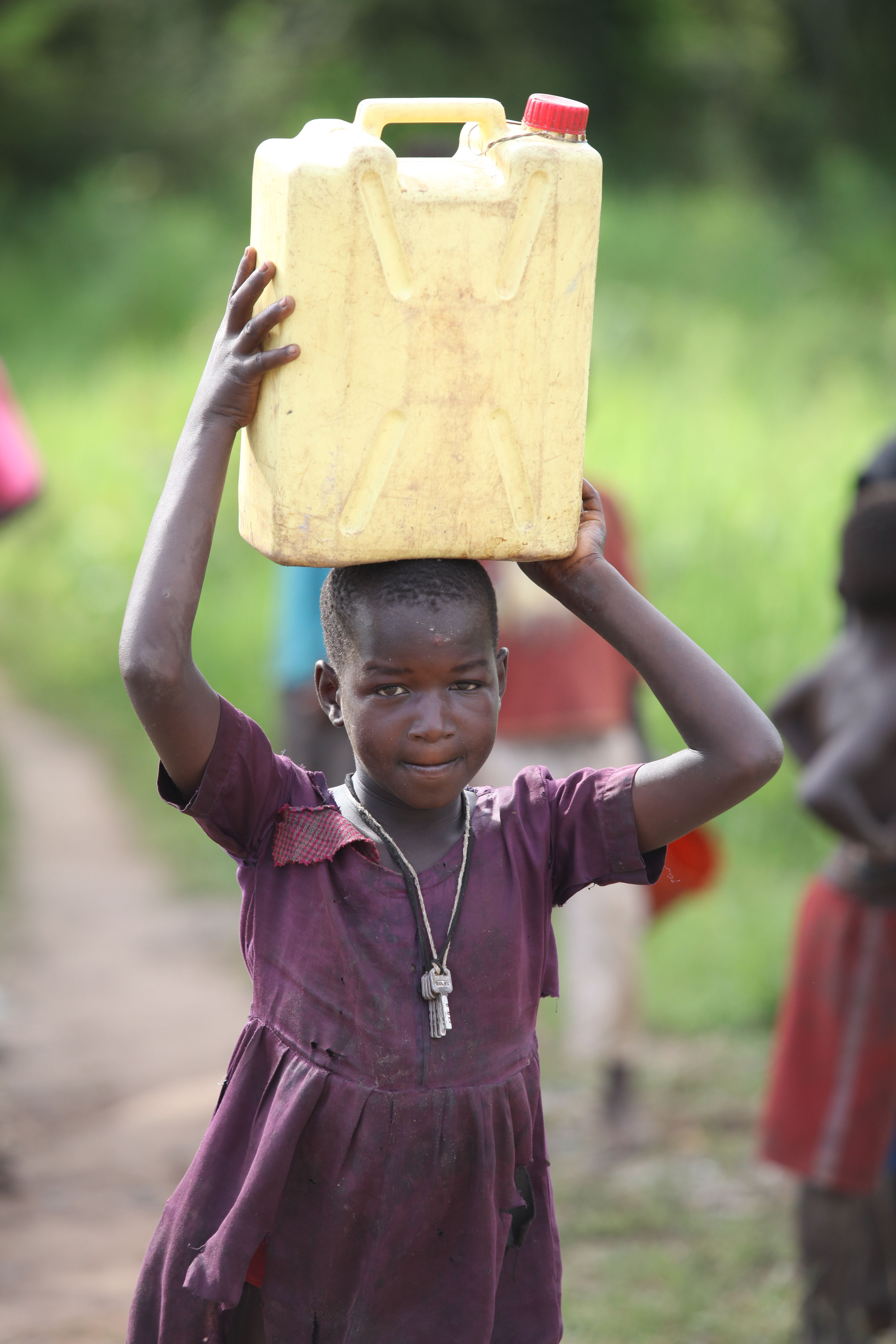 The weight of water that women in Africa carry on their heads is ...