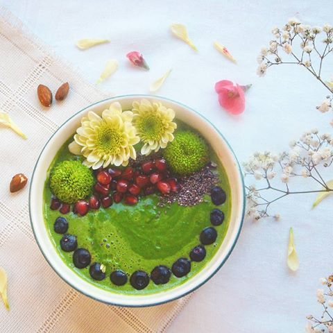 Today green smoothie bowl with baby spinach,kiwi,banana and lettuce&parsley from family garden. Topp...