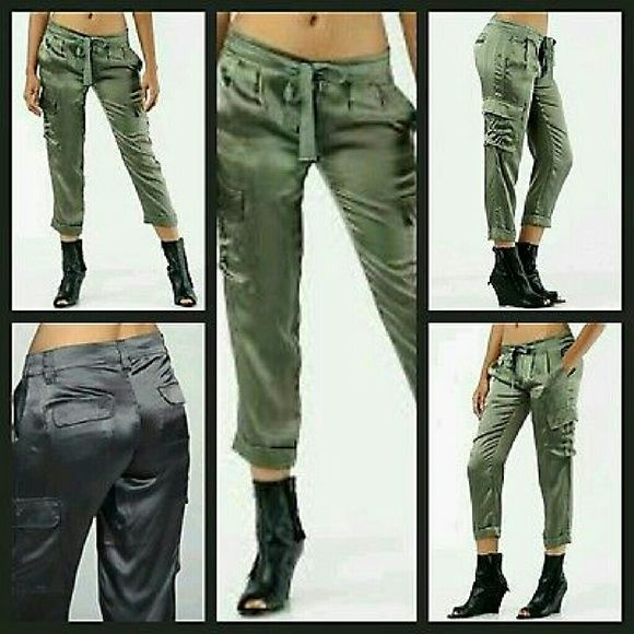 Joie Dilanger Silk Cargo Cropped Pants BLACK COLOR **COLOR IS BLACK*** UNABLE TO FIND PICS ON MODEL IN BLACK SO USED ARMY PICS ON MODEL TO DEMONSTRATE WEAR**same pant diff color BNWT joie Dilanger Cargo Crop.Cuff pants  100% silk satin  Sorry about wrinkles had been folded in my bureau for some time  Msrp $215 *pls note has store retail tag not a JOIE tag is AUTHENTIC  Size 2 Measurments avail upon request  More detail in comments section  (ran out of room..happens a lot =) Reasonable offers…