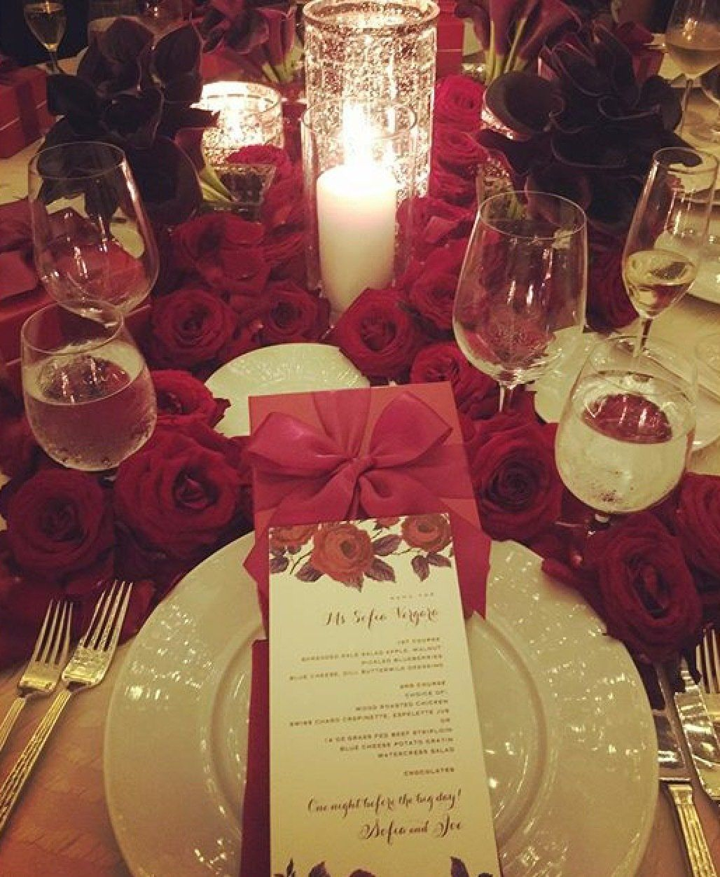 Instead of a rehearsal dinner, there was a dinner hosted by the bride. The theme was red and incredible crimson roses adorned the room.