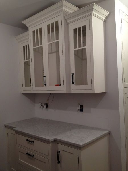 Buffet built of white shaker cabinets with glass doors and for White kitchen cabinets with crown molding