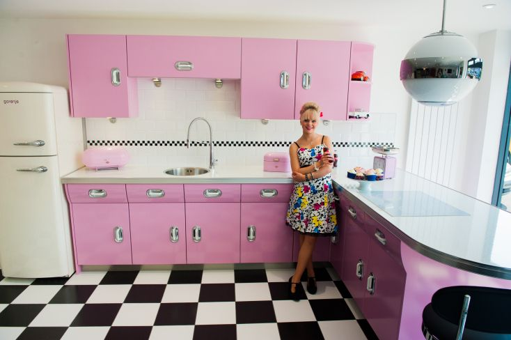 Pink Retro Kitchen With Black And White Tile Floors