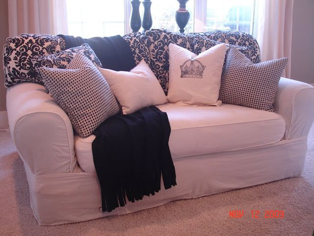 Sure fit slipcover, altered a bit to fit tighter. Notice the ...