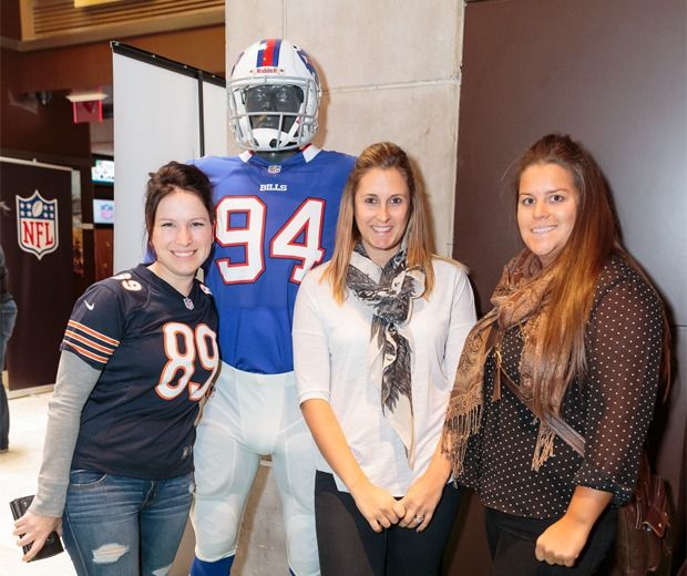Toronto NFL fans posing with their NFL boyfriend at #NFLSundaySocial all women's event.
