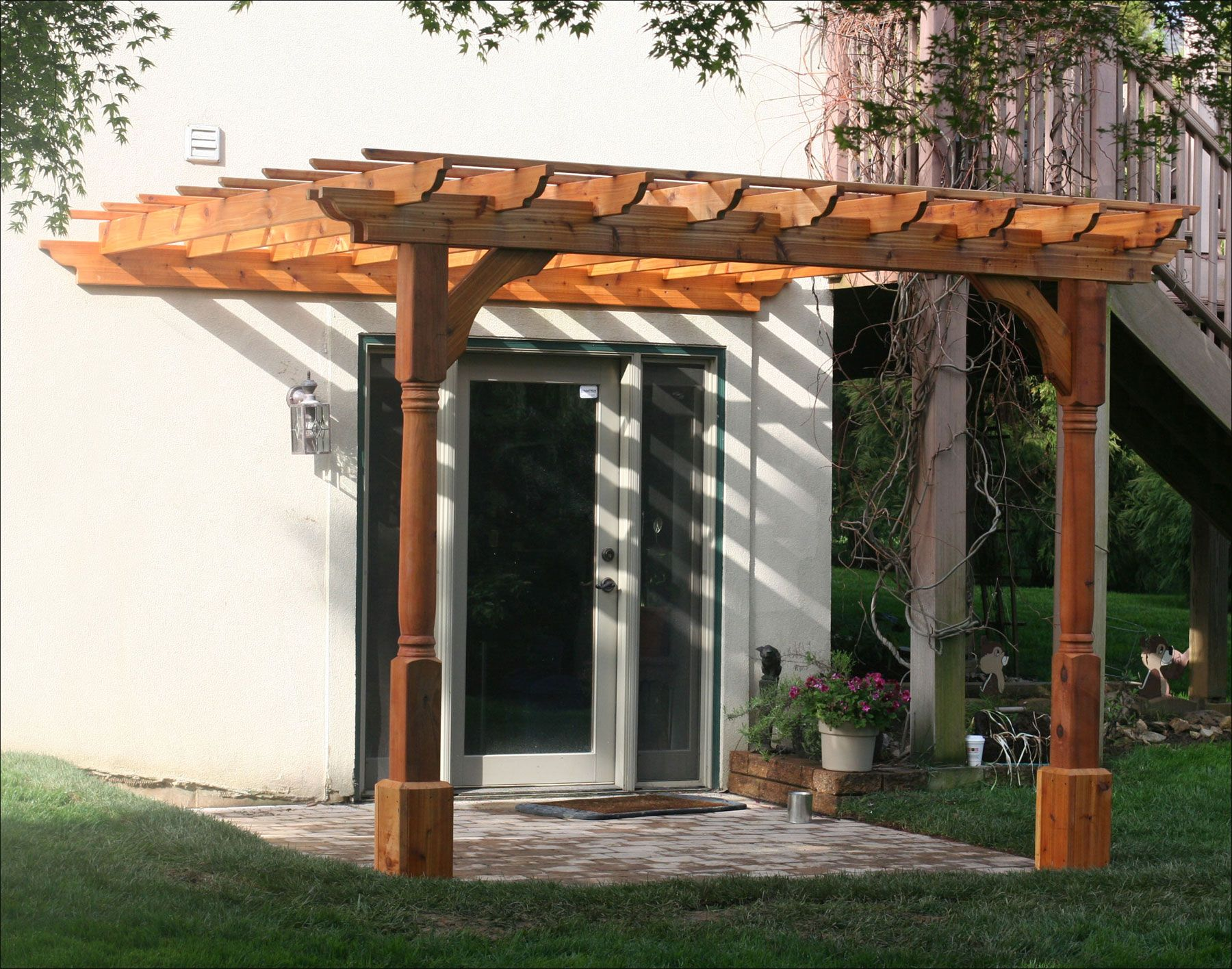 10 X 10 Cedar 2 Beam Pergola Wall Mount With Cedar Tone Stain Sealer And Decorative Posts Pergola Wall Mounted Pergola Pergola Plans Diy