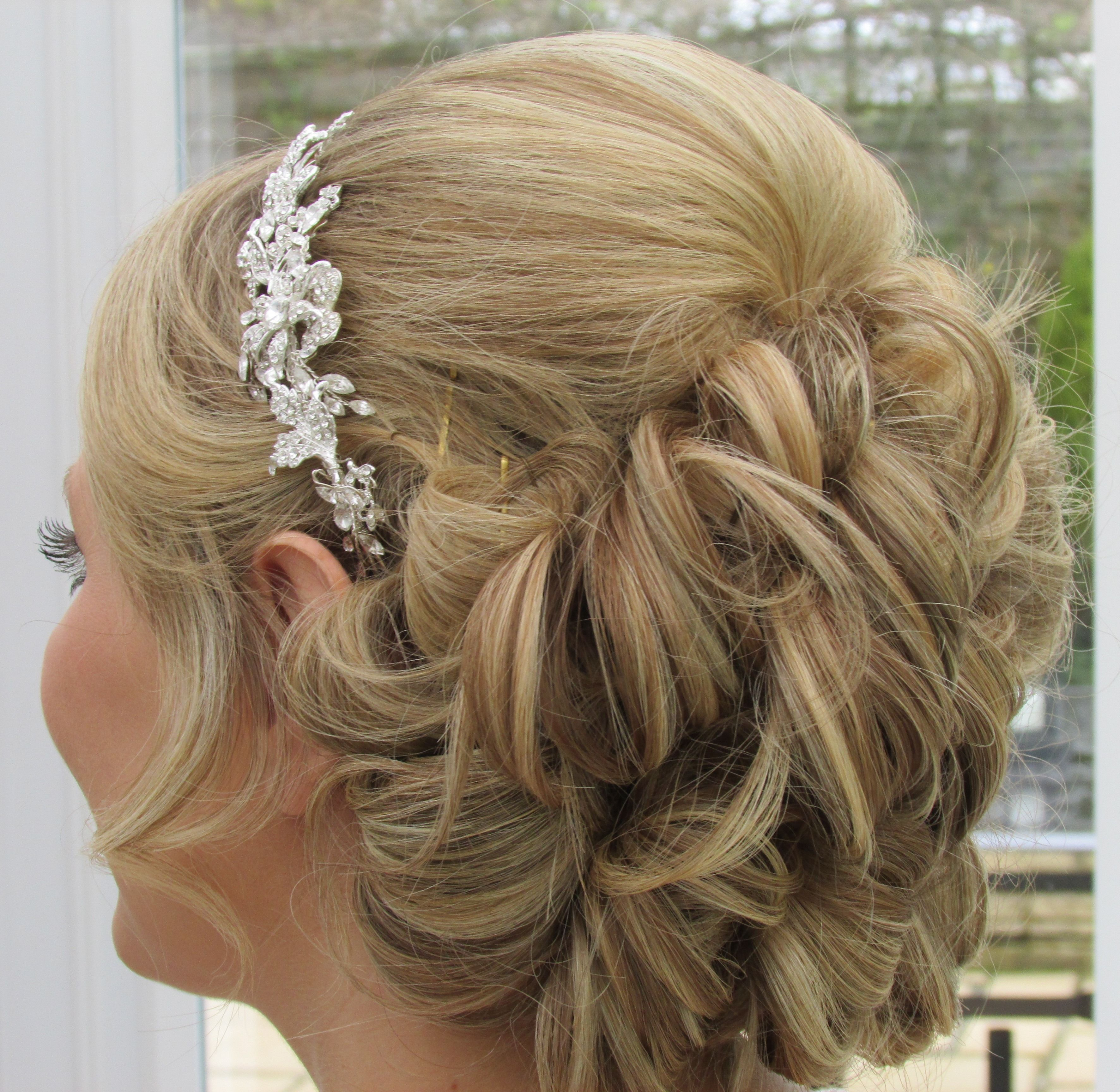 bridal hair upstyle with loose curls and hair extensions
