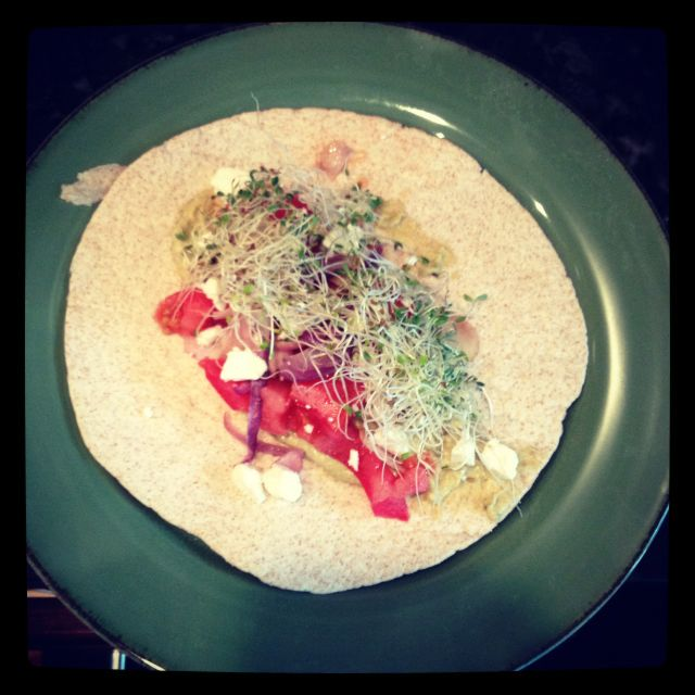 While wheat tortilla, hummus, tomato, onions, sprouts, crumbled low fat feta cheese. Under 150 calories :)