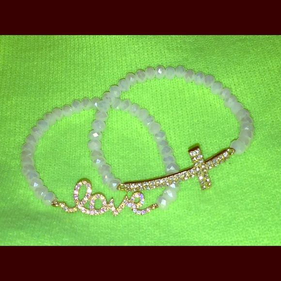 Bracelet package. Two bracelets- one that says love and one that has a cross- both in rhinestones. Very cute and never worn. In great condition! All offers are considered, just use the offer button! Jewelry Bracelets