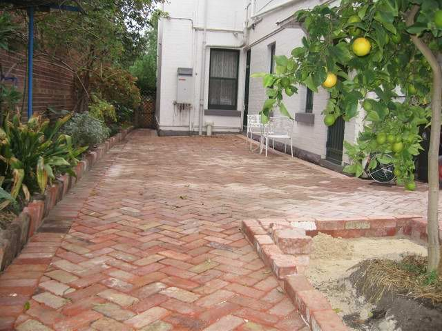 Recycled red brick paving in herringbone pattern house for Red brick patio ideas