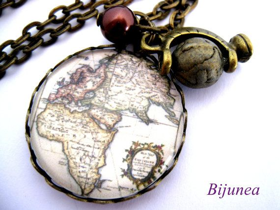 World map necklace =)    This necklace measures about 60cm (24in). =)    ** It can be resized at no extra cost. **    Chain: 60cm (24in). Pendant: 2.5cm