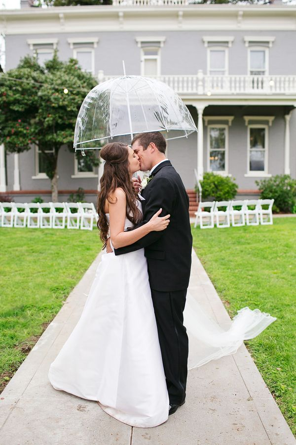 Bride And Groom Kissing Under Clear Wedding Umbrella Umbrella Wedding Rain On Wedding Day Bride And Groom Photos