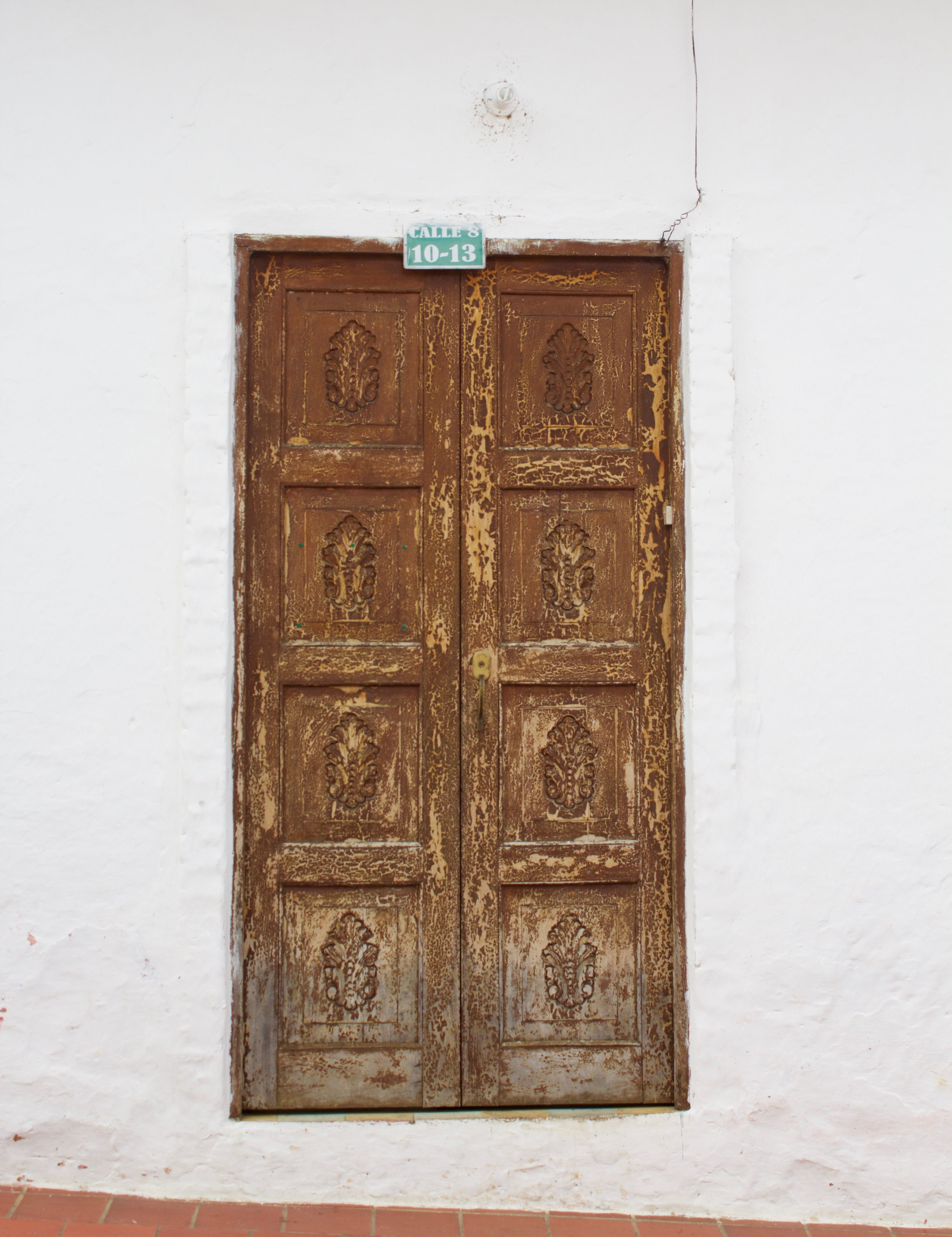 Big wooden doors are a typical site in small towns across #Colombia. They adorn the cobbled streets beautifully. #Architecture #Travel