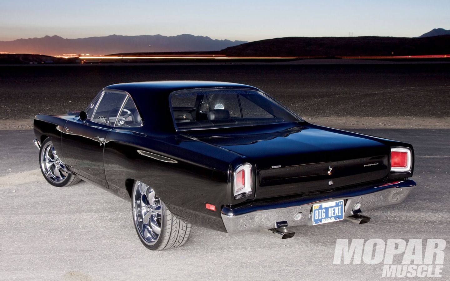 1969 Road Runner minus the dumb wheels. It's supposed to be a SLEEPER. Not some flashy car