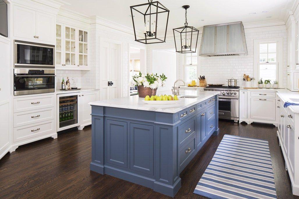 White Kitchen With Dark Wood Floors Kitchen With Box Pendant Lights Over Blue Kitchen Island With Wh Blue Kitchen Island White Kitchen Design Kitchen Interior