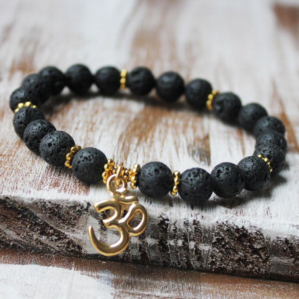 OM Bracelet Healing Jewelry Black Lava Wrist Mala Yoga Zen Jewelry by DazzleDream on Etsy https://www.etsy.com/listing/181301759/om-bracelet-healing-jewelry-black-lava