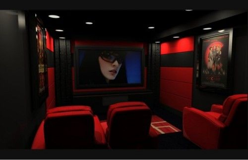 Red is an unexpected color for a home theater, but the result is a ...
