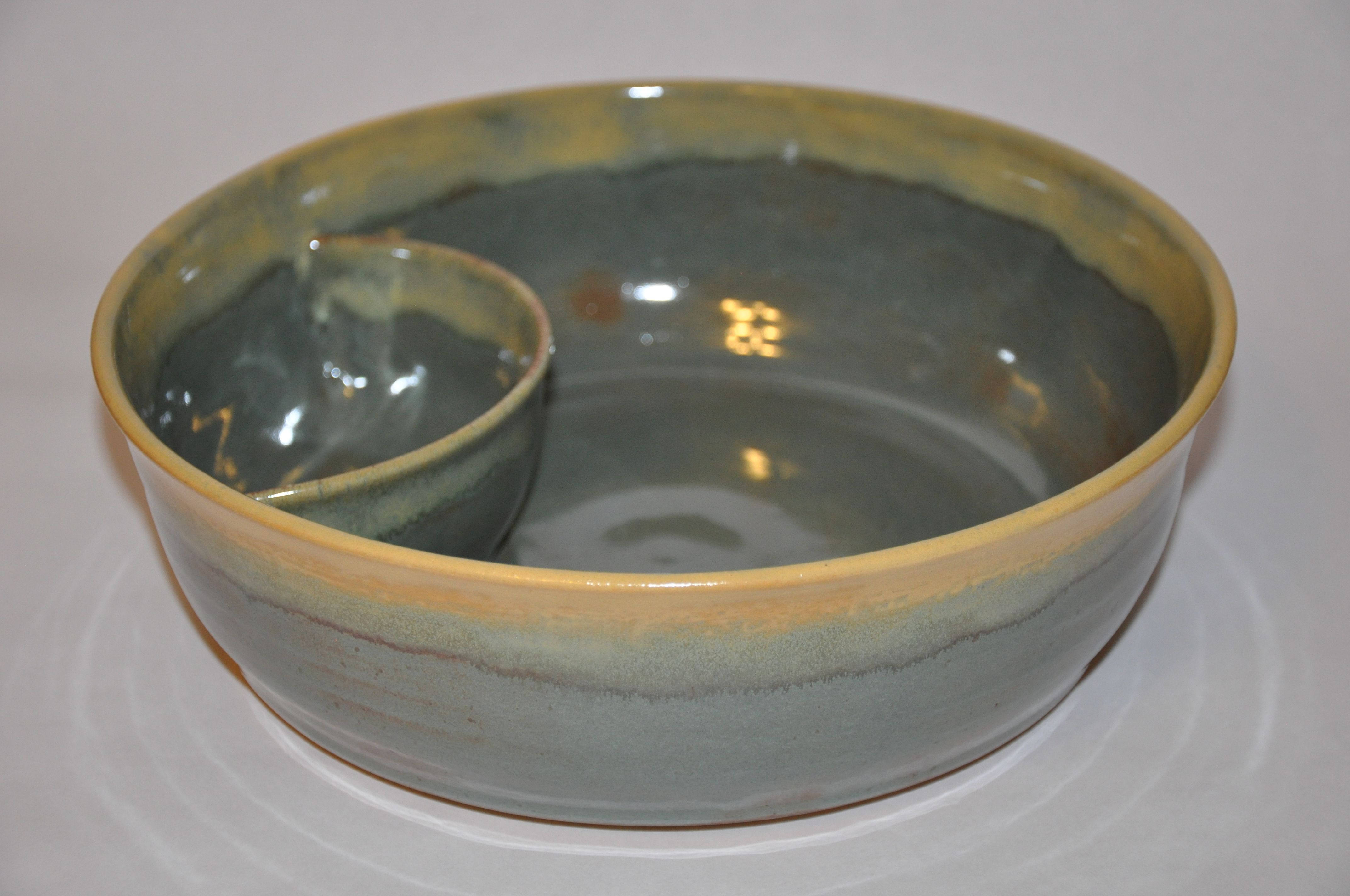 "I made this chip and dip bowl on the potter's wheel. It is stoneware, fired at cone 6. This bowl is 2 3/4"" H and 9"" W. By Quillay Pottery."
