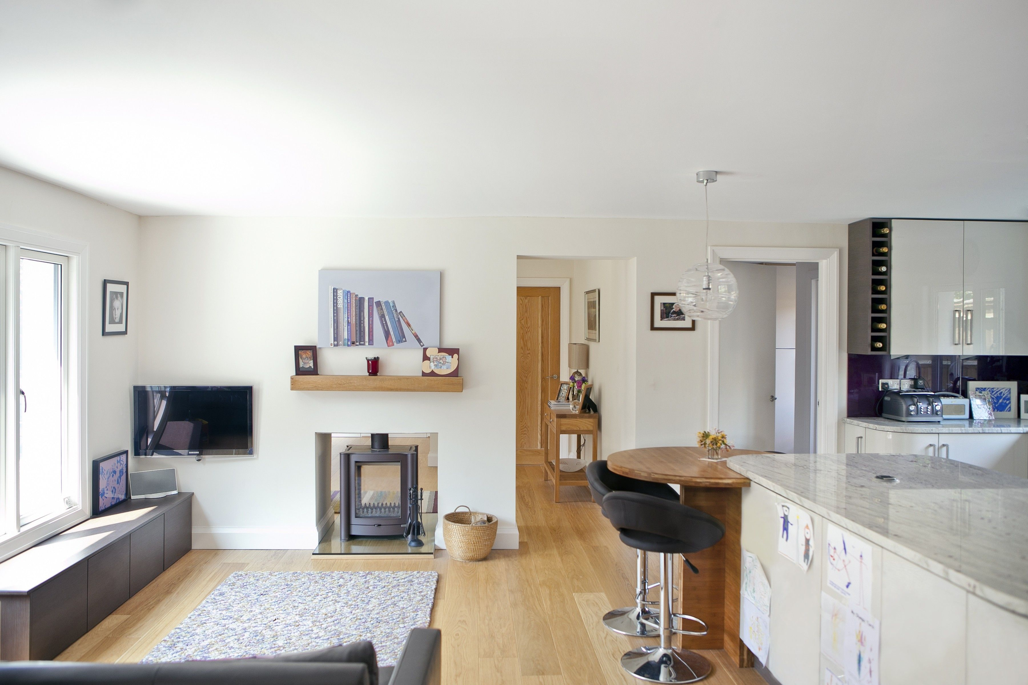 The Penthouse open plan living carefully defined with oak floor and ...