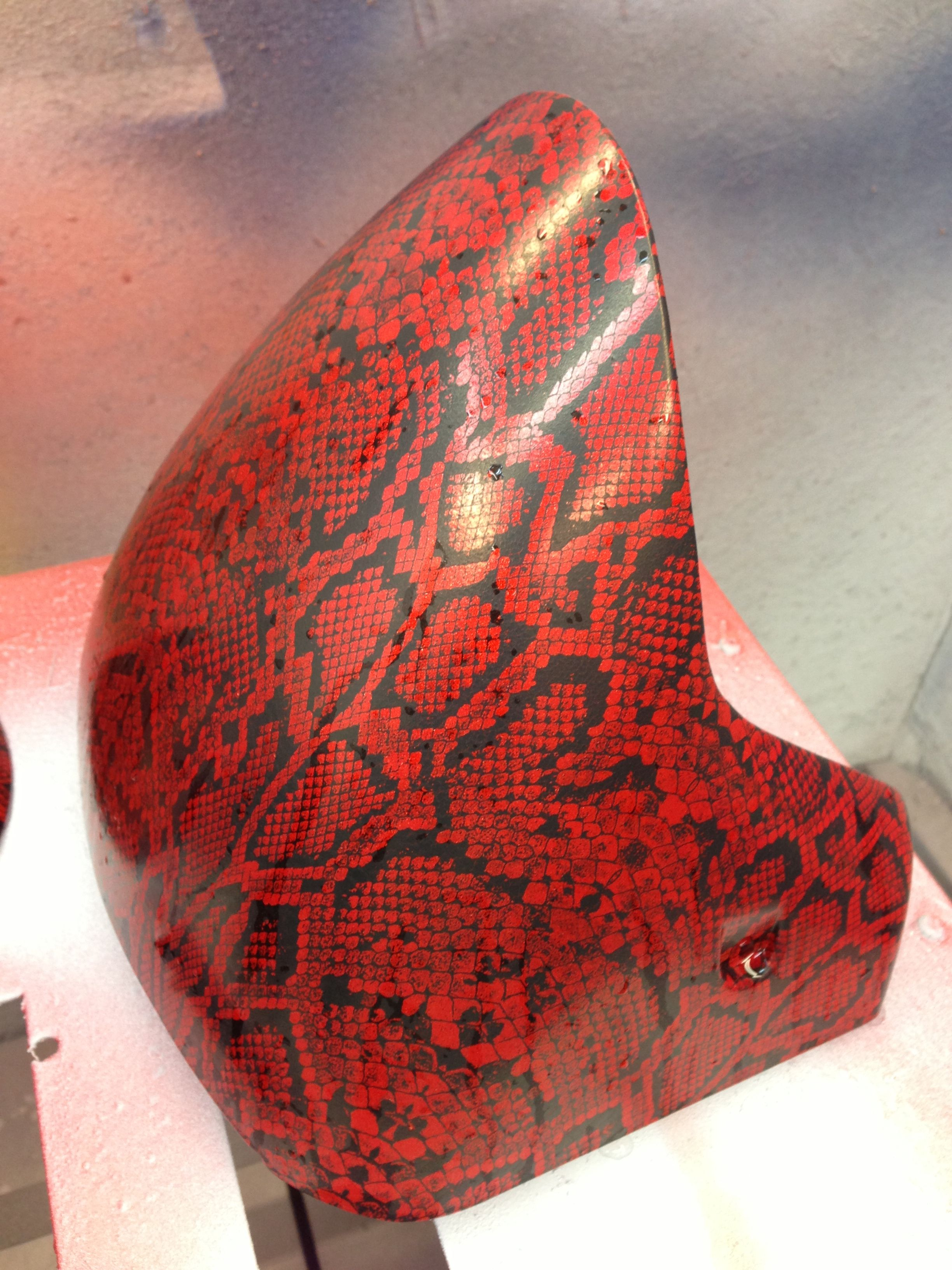 Motorcycle fender in candy apple red with snake skin print