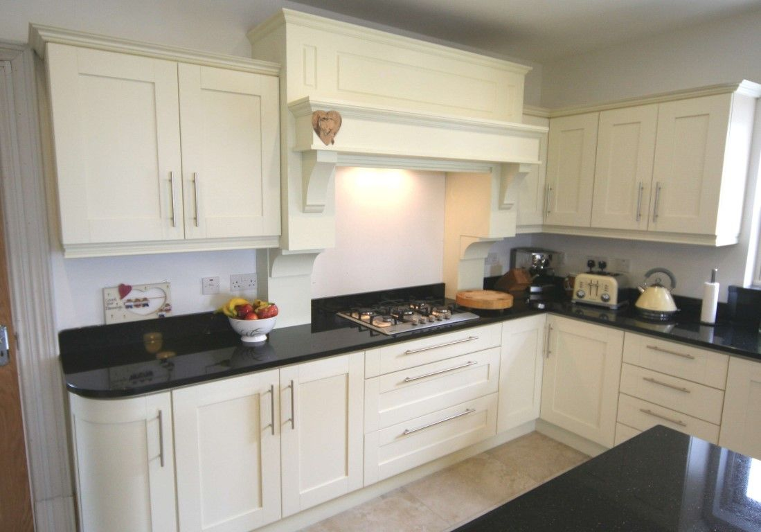Interesting white kitchen units black worktop kashmir gold for Kitchen units and worktops