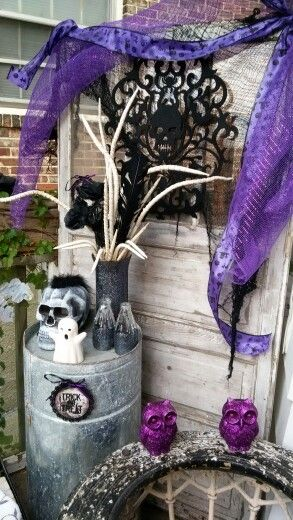 k, white and purple front porch Halloween decorations On a budget