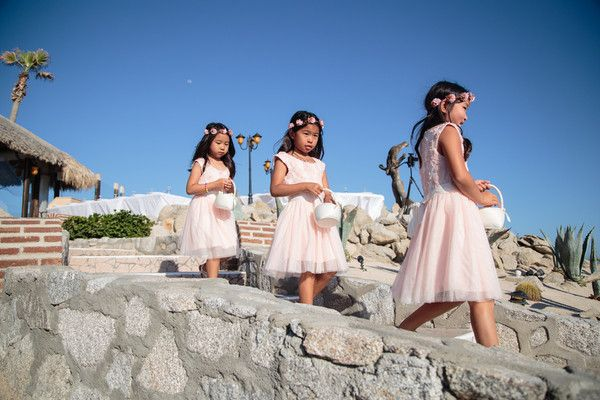 Flower girl dress idea - pink, knee-length gowns with lace bodices and tulle skirts {Anna Gomes Photography}