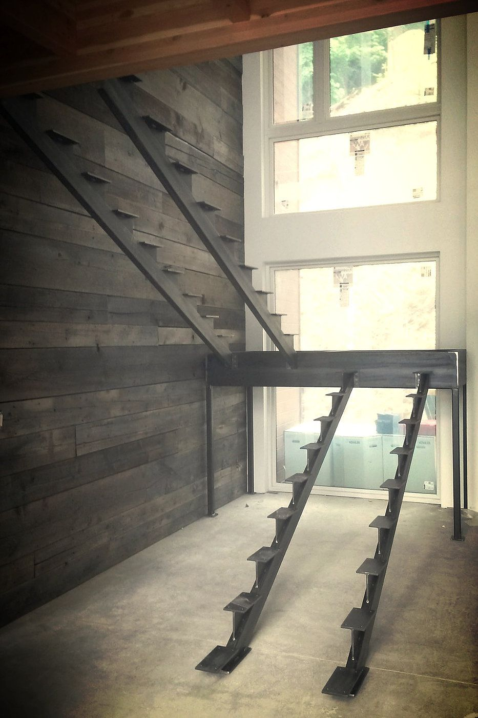 Steel stair stringers are a striking alternative