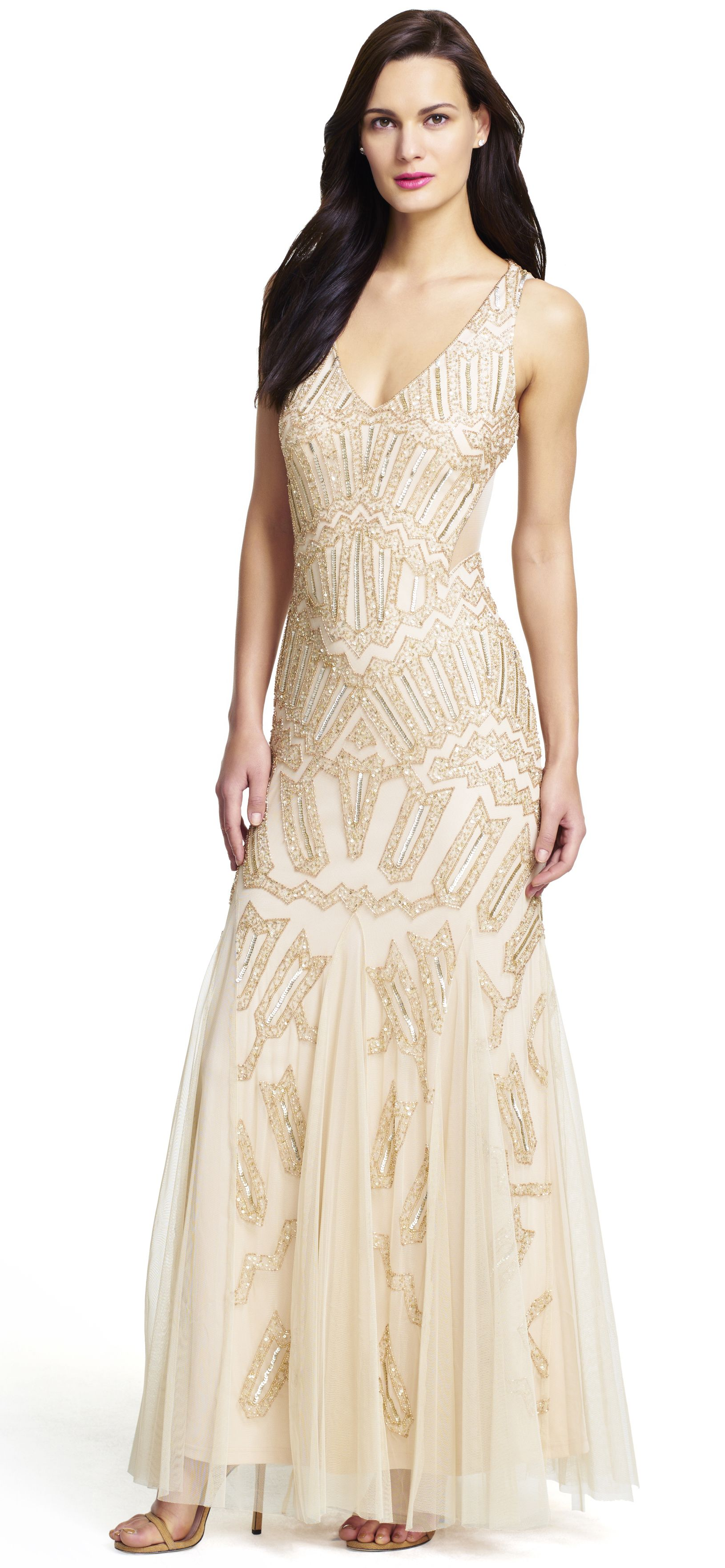Long beaded gown with cutout sides
