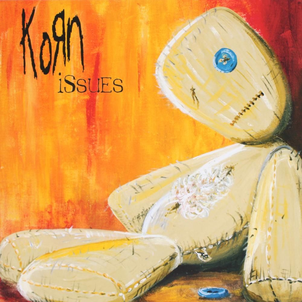 Korn ; Issues ( 1999 ) Korn, Music album cover